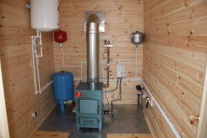 Как обогреть дом без газа и электричества своими руками?